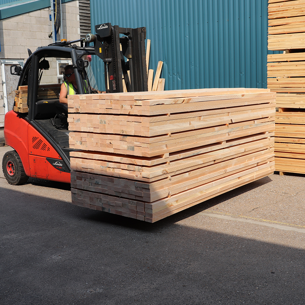 Timber being transported around site for packing on a forklift