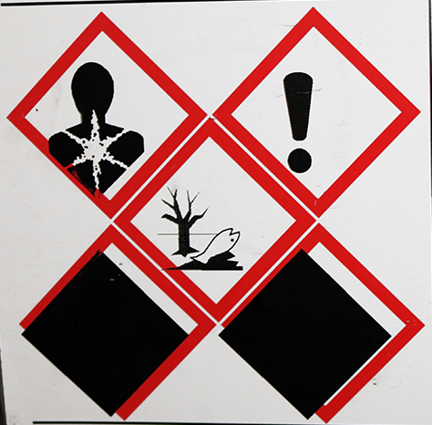 Chemical label with red diamonds overprinting with thermal printer that is not central