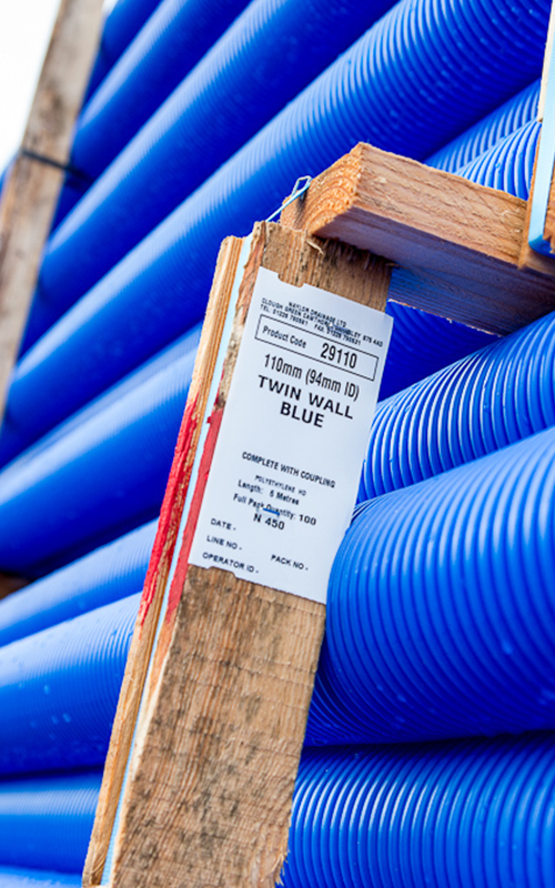 Industrial tags on wood next to plastic tubing