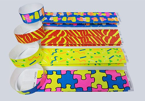 Various patterned tyvek wristbands including puzzle and zebra